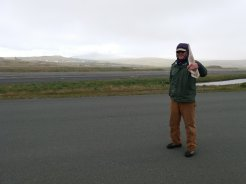 Capt Craig carrying a piece of angle iron gifted to us by a resident of Adak to reinforce our boom